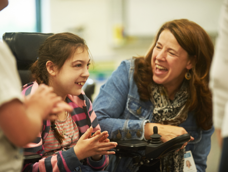 Northwest AEA employee working with a student in a wheelchair